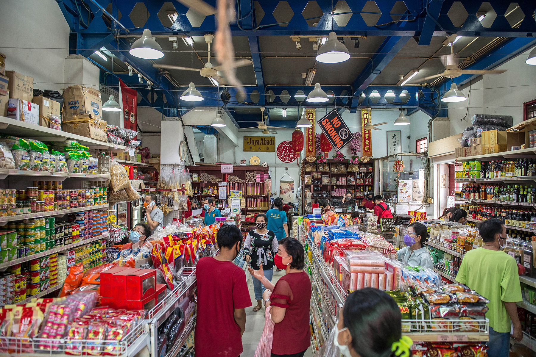 A Chinese grocery store with customers