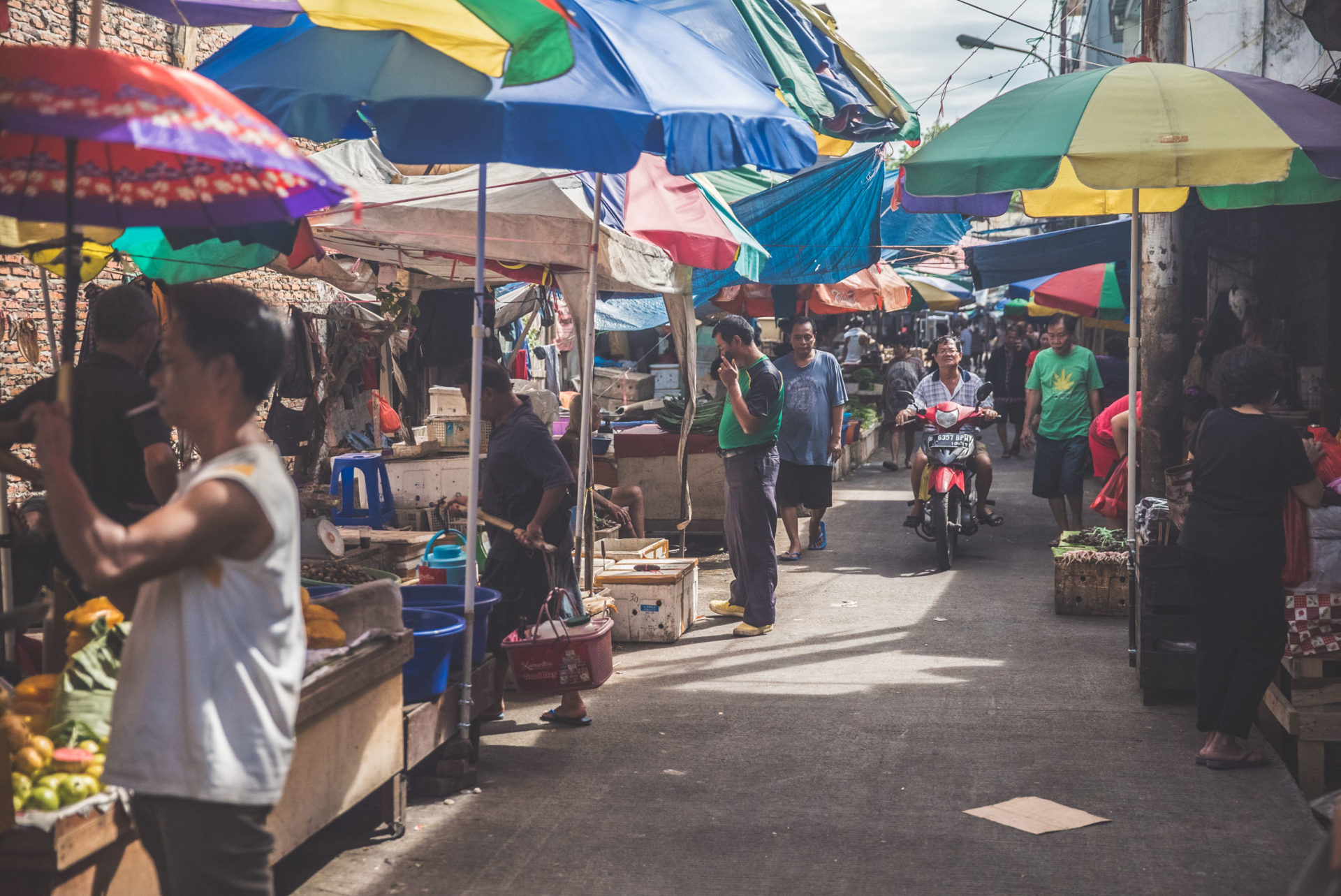 Busy market with many colourful parasols