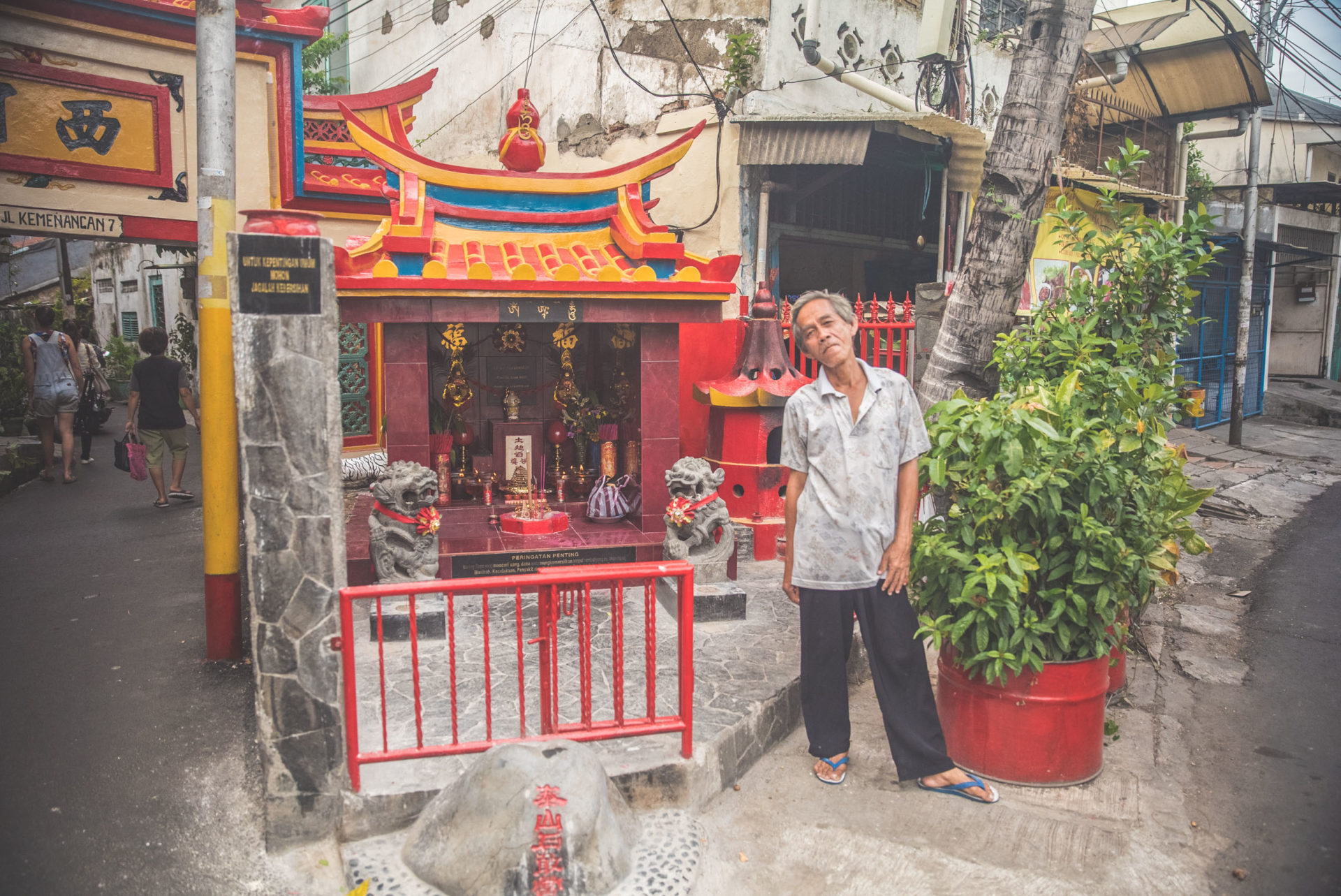 A shrine with two statues and burning incense